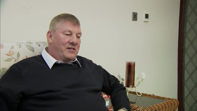 lorry driver who pulled woman from burning car presented with award; england: int john rastrick interview sot - berufsfahrer stock-videos und b-roll-filmmaterial