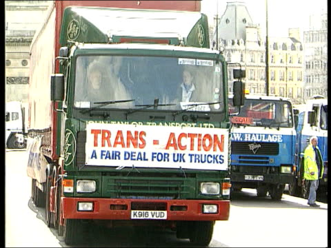 government unmoved lib england london park lane lorries blockading park lane in protest against road tax and fuel duties lorry with 'transaction'... - blocking stock videos and b-roll footage