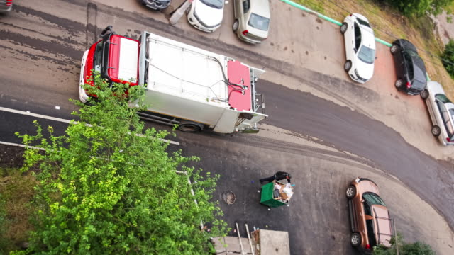 a lorry for garbage collection removes waste from residential buildings. - garbage truck stock videos & royalty-free footage