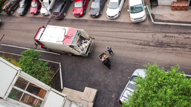 a lorry for garbage collection removes waste from residential buildings. - picking up stock videos & royalty-free footage
