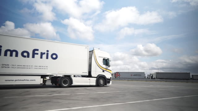 lorry park at channel tunnel entrance in calais, full of refrigerated lorries carrying food for the uk - eurotunnel folkestone stock-videos und b-roll-filmmaterial