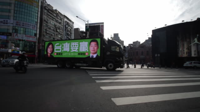 a lorry with a billboard displaying the face of taiwan president tsai ingwen on a street in taipei - taiwan stock videos & royalty-free footage