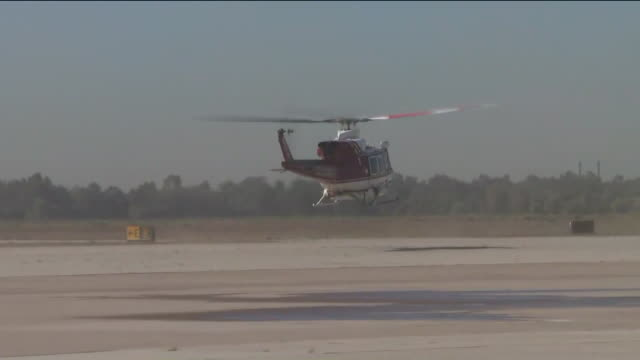 los angeles, ca, u.s. - a ch-47 twin-engine, tandem rotor helicopter flying above tarmac during a press event in los alamitos, ca, on wednesday,... - water fight stock videos & royalty-free footage