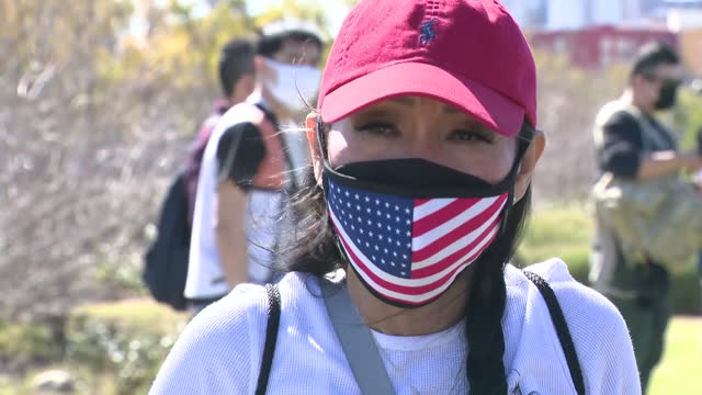 los angeles, ca, u.s. - activists being interviewed during protest against attacks on asian american citizens in los angeles state historic park.... - asian and indian ethnicities stock videos & royalty-free footage
