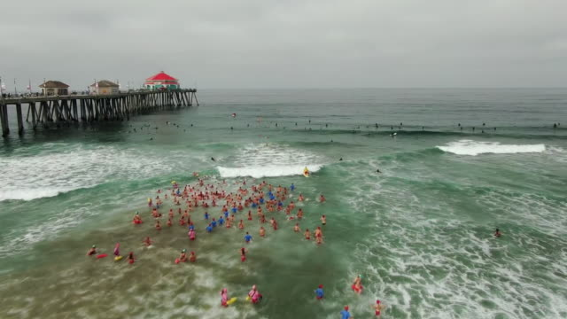 los angeles, ca, u.s. - aerail view of people attending huntington beach surf camp on friday, august 2, 2019. - attending stock videos & royalty-free footage