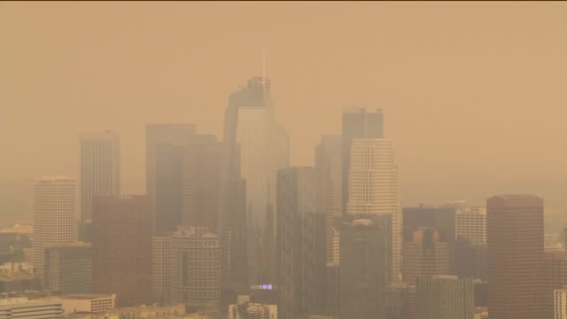 los angeles, ca, u.s. - aerial view - downtown bathed in smoke, unhealthful air from fires. on friday, september 11, 2020. - air pollution stock videos & royalty-free footage