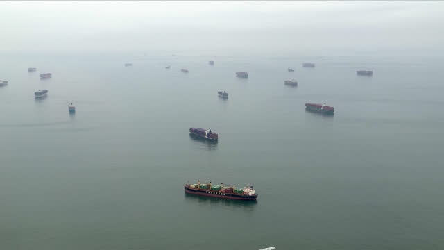 los angeles, ca, u.s. - aerial view - large group of container ships in port of los angeles. port of los angeles seeing cargo backups amid surging... - port of los angeles stock videos & royalty-free footage