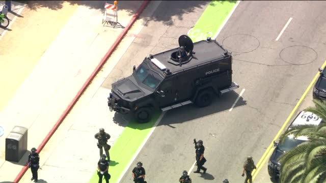 ktla los angeles ca us aerial view of armored police vehicle and protestors during george floyd protest on sunday may 31 2020 - 機動隊点の映像素材/bロール