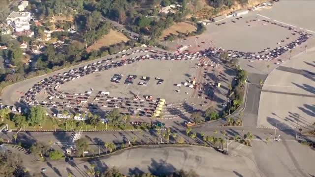 los angeles, ca, u.s. - aerial view of cars queuing at dodger stadium covid-19 testing site. on monday, january 4, 2021. - dividing line stock videos & royalty-free footage