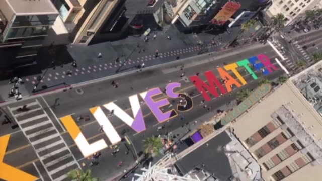 """los angeles, ca, u.s. - aerial view of colorful """"all black lives matter"""" painted on hollywood blvd in front of the dolby theatre on saturday, june... - hollywood california stock videos & royalty-free footage"""