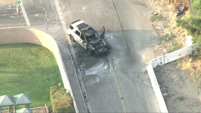 los angeles, ca, u.s. - aerial view of crime scene where a deputy was shot and wounded during an attempted traffic stop in san bernardino, on... - helicopter point of view stock videos & royalty-free footage