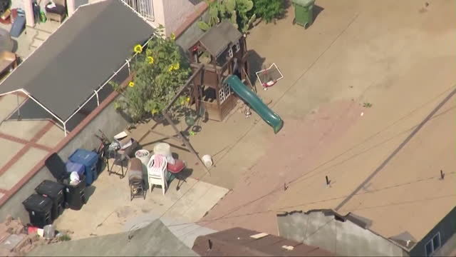 los angeles, ca, u.s. - aerial view of east neighborhood where 3 young children where found dead on tuesday, june 29, 2021. responding to a call from... - helicopter point of view stock videos & royalty-free footage