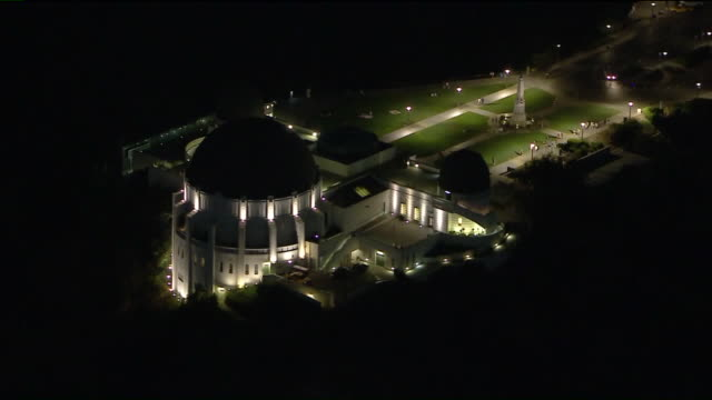 los angeles, ca, u.s. - aerial view of griffith observatory illuminated at night on thursday, october 1, 2020. - griffith observatory stock videos & royalty-free footage