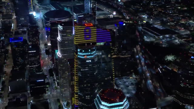 los angeles, ca, u.s. - aerial view of los angeles downtown skyscrapers illuminated in remembrance of kobe bryant at night on wednesday, january 27,... - number 8 stock videos & royalty-free footage