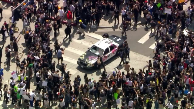 ktla los angeles ca us – aerial view of people jumping on patrol car in la during protest over george floyd's death on saturday may 30 2020 - george floyd stock videos & royalty-free footage