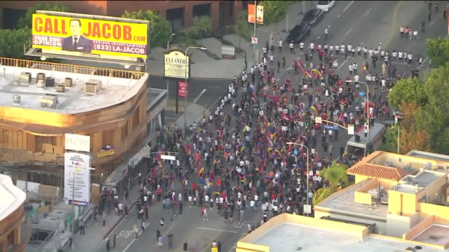 los angeles, ca, u.s. - aerial view of protestors hold posters and flags at an armenian azerbaijan protest on wednesday, september 30, 2020. hundreds... - other stock videos & royalty-free footage