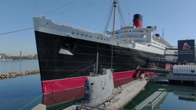 los angeles, ca, u.s. - aerial view of rms queen mary docked in long beach, california, on thursday, may 7, 2020. - moored stock videos & royalty-free footage