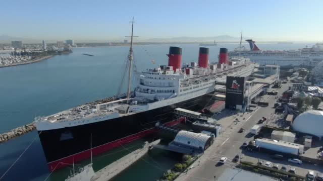 los angeles, ca, u.s. - aerial view of rms queen mary moored in long beach, california, on thursday, may 7, 2020. - long beach california stock videos & royalty-free footage