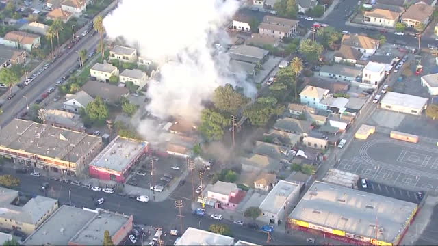 los angeles, ca, u.s. - aerial view of smoke rising from detonation of illegal fireworks that left 17 injured, including 10 lapd officers, on... - helicopter point of view stock videos & royalty-free footage