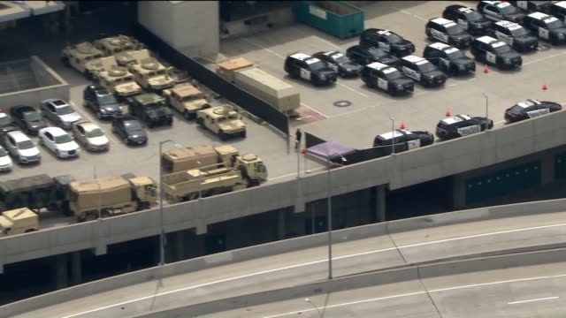 los angeles, ca, u.s. - aerial view - police and military vehicles in l.a. convention center on sunday, may 31, 2020. - military land vehicle stock videos & royalty-free footage