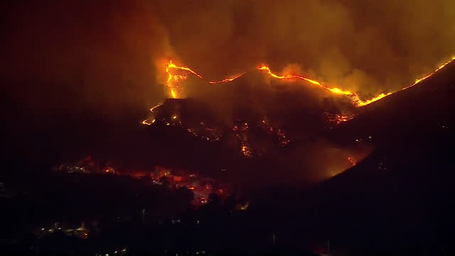 los angeles, ca, u.s. - aerial view - zooming out of hills covered with blue ridge wildfire in yorba linda. fire crews battling the blue ridge fire... - western usa stock videos & royalty-free footage