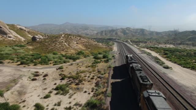 los angeles, ca, u.s. - aerial views of cargo trains crossing mormon rocks interpretive trail, a 1 mile loop trail located near san bernardino on... - 貨物列車点の映像素材/bロール