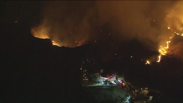 los angeles, ca, u.s. - aerial views of fire crews battle 60-acre blaze near homes in redlands at night on wednesday, october 14, 2020. crews were... - fire engine stock videos & royalty-free footage