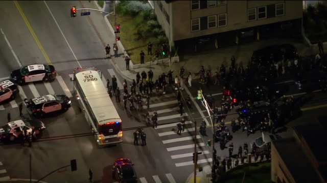 ktla los angeles ca us aerial views of police officers and protestors on streets at night amid george floyd protests in hollywood on tuesday june 2... - arrest stock videos & royalty-free footage