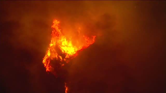 los angeles, ca, u.s. - aerial views of the bobcat fire burning in the angeles national forest at night on monday, september 14, 2020. the fire has... - california stock videos & royalty-free footage