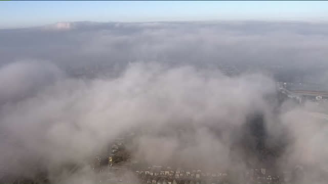 ktla los angeles ca us aerials silhouette of helicopter on fog covering los angeles on tuesday august 13 2019 - covering stock videos & royalty-free footage