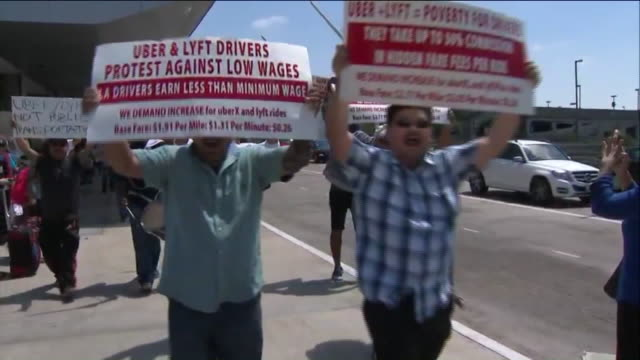 los angeles, ca, u.s. - airport employees, uber and lyft drivers and other workers marching on lax to demand support for the ƒ??unions for allƒ?�... - western script stock videos & royalty-free footage