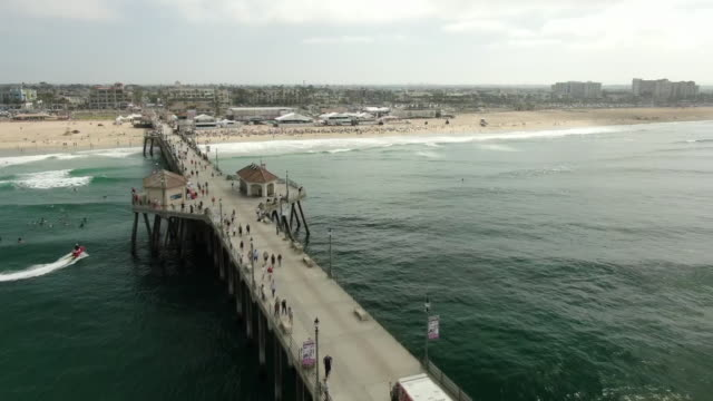 ktla los angeles ca us an aerial view of people attending huntington beach surf camp on friday august 2 2019 - huntington beach california stock videos and b-roll footage