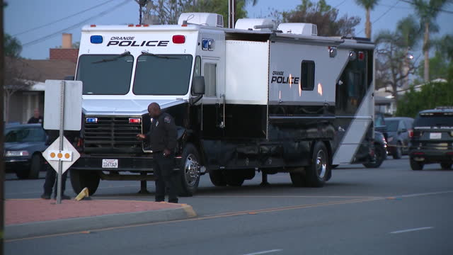 los angeles, ca, u.s. - barricade tape and police vehicles at orange mass shooting crime scene on wednesday, march 31, 2021. - flash stock videos & royalty-free footage
