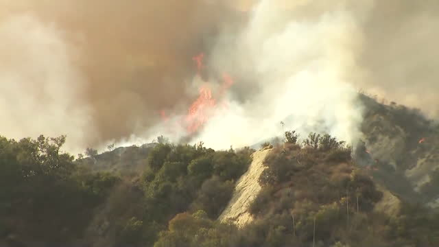 los angeles, ca, u.s. - brush fire in santa monica mountains as authorities identify and charge arson suspect, on tuesday, may 18, 2021. - california stock videos & royalty-free footage