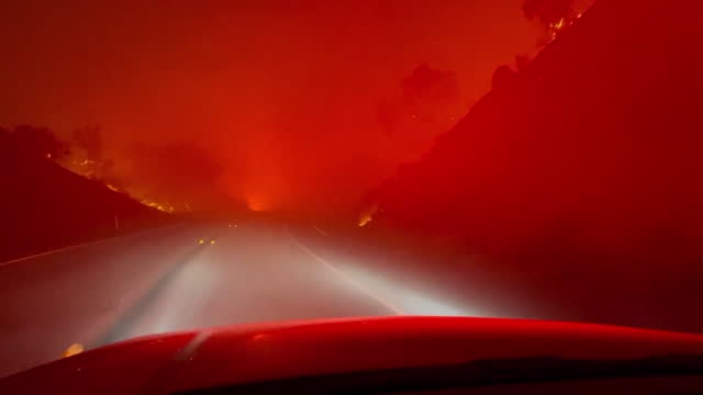 los angeles, ca, u.s. - car driving through forest fire in orange county on thursday, december 3, 2020. - western usa stock videos & royalty-free footage