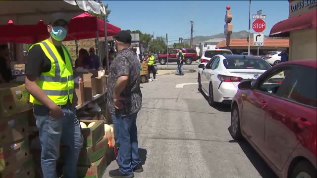 los angeles, ca, u.s. - cars waiting in line along stalls with food distributed by yasiel puig's foundation. yasiel puig's wild horse children's... - sharing stock videos & royalty-free footage