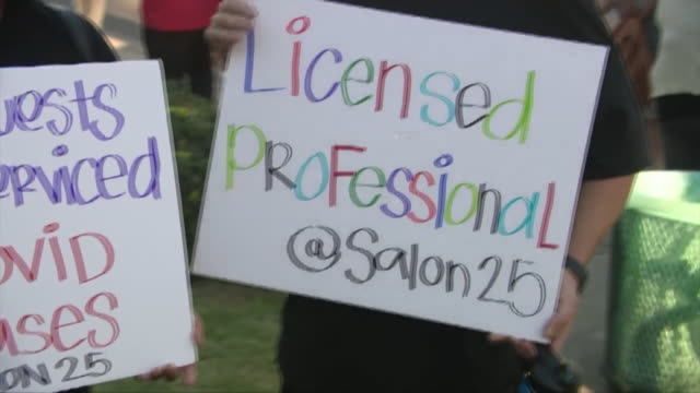 ktla los angeles ca us closeups of protestors' placards a group of local salon owners and employees rallied in santa clarita saturday to demand the... - santa clarita video stock e b–roll