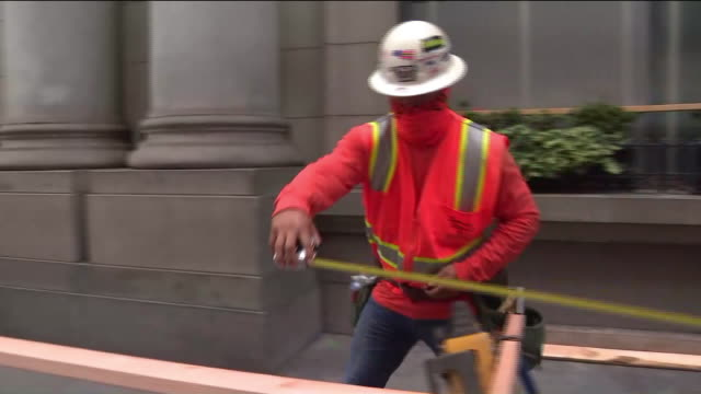 ktla los angeles ca us construction workers boarding up store windows as george floyd protests continue on thursday june 4 2020 - construction worker stock videos & royalty-free footage