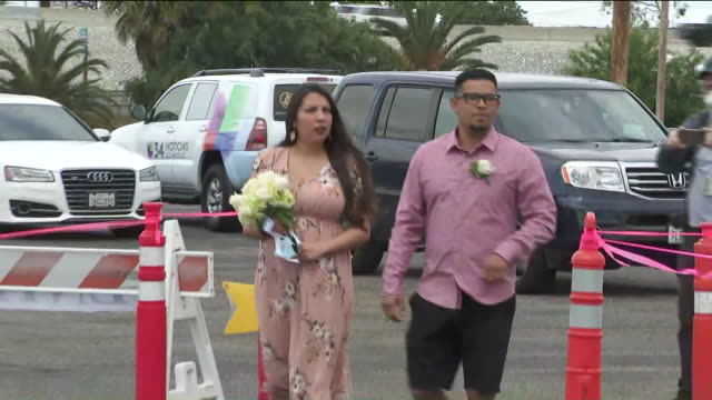 ktla los angeles ca us couple getting married and posing for photographs at the honda center in anaheim the orange county clerkrecorder department... - honda center anaheim stock videos & royalty-free footage