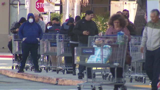 los angeles, ca, u.s. - customers waiting in line to enter sam's club store. sam's club announced two new programs at stores nationwide that will... - waiting in line stock videos & royalty-free footage