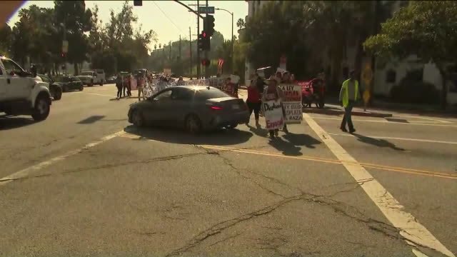 """los angeles, ca, u.s. - demonstrators hitting the streets from echo park to sunset boulevard during """"days of rage"""" march which pushes for repeal of... - western script stock videos & royalty-free footage"""