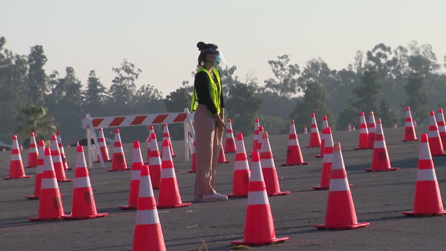 los angeles, ca, u.s. - dodger stadium covid-19 testing site divided by traffic cones. on monday, january 4, 2021. - dividing line stock videos & royalty-free footage