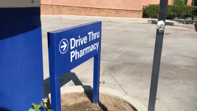 los angeles, ca, u.s. - drive through pharmacy building exteriors on wednesday, july 15, 2020. - wall building feature stock videos & royalty-free footage