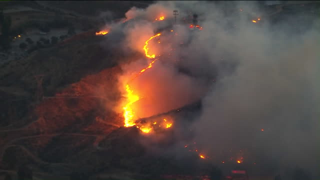 los angeles, ca, u.s. - drone view of bush fire in castaic. firefighters are working to contain a wind-driven brush fire that broke out near the jack... - california stock videos & royalty-free footage