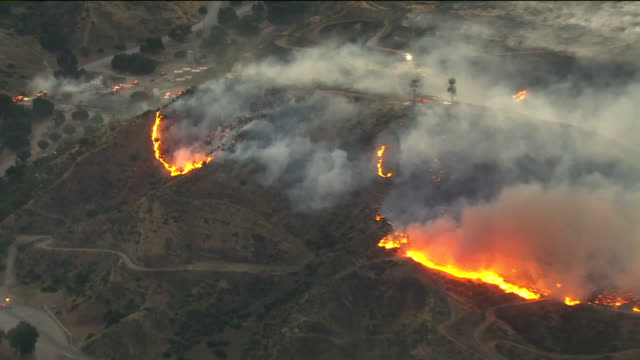 los angeles, ca, u.s. - drone view of bush fire near jack bones equestrian center. firefighters are working to contain a wind-driven brush fire that... - western usa stock videos & royalty-free footage