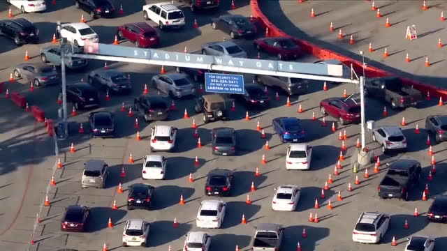 los angeles, ca, u.s. - drone view of cars waiting in line at dodger stadium covid-19 testing site. on monday, january 4, 2021. - dividing line stock videos & royalty-free footage