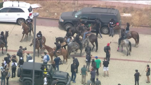 los angeles, ca, u.s. - drone view of compton cowboys protesting. hundreds of people took to the streets in a demonstration against police violence.... - cowboy stock videos & royalty-free footage