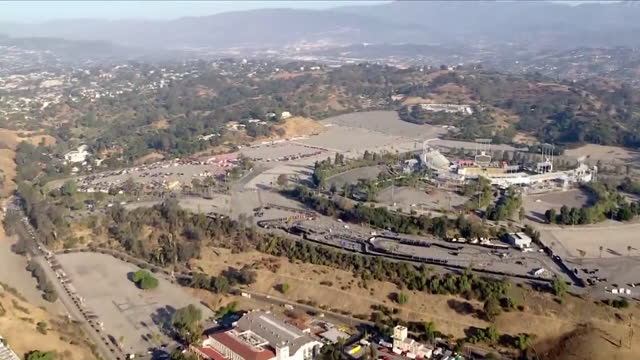 los angeles, ca, u.s. - drone view of dodger stadium as covid-19 testing site. on monday, january 4, 2021. - dividing line stock videos & royalty-free footage