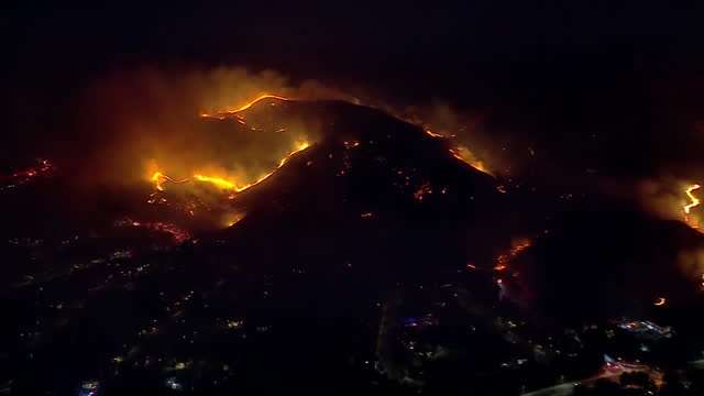 los angeles, ca, u.s. - drone view - zooming out of hills covered with blue ridge wildfire in yorba linda. fire crews battling the blue ridge fire... - extreme weather stock videos & royalty-free footage