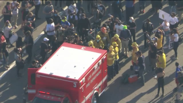los angeles, ca, u.s. - emergency services transporting injured during rally protesting g. floyd's death, on wednesday, may 27, 2020. - injured stock videos & royalty-free footage